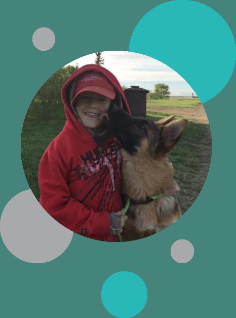 Boy with German Shepherd